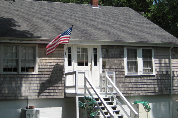 Gray Home with American flag